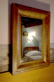 Room 32, reflection of twin bed in mirror, perpindicular to queen bed, private bath/A/C