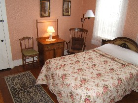 Wellfleet Inn. Room 29, second floor with One Queen Bed shares a bath with Room 30.