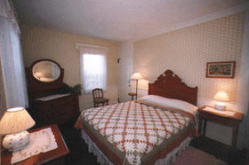 Wellfleet MA lodging Queen Bed, corner room, first floor, view of pond, Room 17